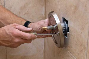 Installing a chrome shower knob in Surfside